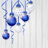 Blue Christmas balls and tinsel on wooden background Stock Photo