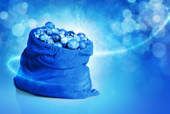 Blue christmas balls and toys in Santa bag Royalty Free Stock Photos