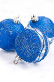 Blue Christmas balls on a white background, closeup, vertical Stock Photos
