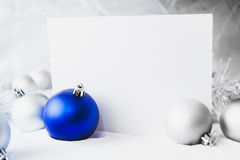 Blue Christmas balls. On the white snow Stock Photos