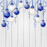 Blue Christmas balls on wooden background Royalty Free Stock Photography