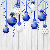Blue Christmas balls on wooden background Stock Photo