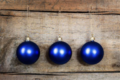 Blue christmas balls on a wooden background Stock Photos