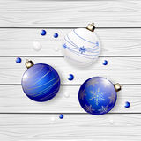 Blue Christmas balls on wooden background Stock Photography