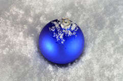 Blue christmas bauble. Blue bauble christmas on natural snow background Stock Photography