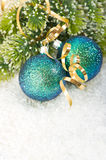 Blue christmas bauble with christmas tree branch. In snow decoration Stock Photos