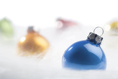 Blue Christmas bauble in decorative snow Stock Photo