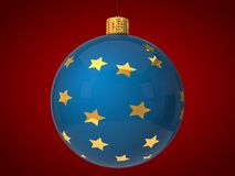 Blue christmas bauble with golden stars on surface Stock Photo