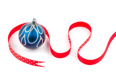 Blue Christmas bauble and red dotted ribbon. Isolated on white Stock Image