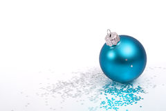 Blue Christmas bauble and silver stars. On white background Royalty Free Stock Photography
