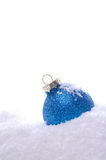 Blue Christmas bauble. With snow Stock Photos