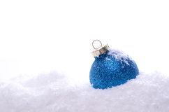 Blue Christmas bauble on snow. With a white background Stock Photography