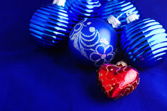 Blue Christmas baubles. With silver decoration and one christmas ball look like heart Royalty Free Stock Photo