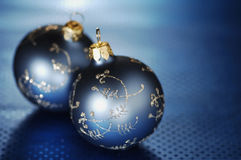 Blue Christmas Baubles on Blue Background Royalty Free Stock Photos