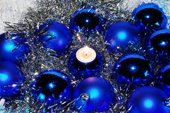 Blue Christmas baubles and a candle Royalty Free Stock Photography