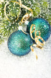 Blue christmas baubles with christmas tree branch Stock Photography