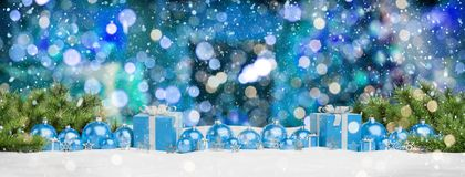 Blue christmas baubles and gifts lined up 3D rendering. Blue christmas gifts and baubles lined up on blue background 3D rendering royalty free illustration