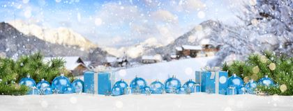 Blue christmas baubles and gifts lined up 3D rendering. Blue christmas gifts and baubles lined up on mountain background 3D rendering vector illustration