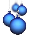 Blue Christmas baubles. Group of hanging blue Christmas baubles with white background Royalty Free Stock Images