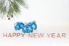 Blue Christmas baubles and Happy New Year wishes Royalty Free Stock Photography