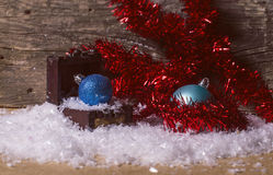 Blue christmas baubles and red tinsel Stock Photo