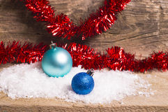 Blue christmas baubles and red tinsel Royalty Free Stock Images