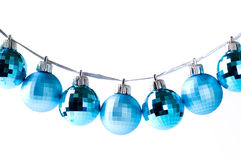 Blue Christmas baubles on silver ribbon isolated Royalty Free Stock Photos
