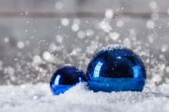 Blue Christmas baubles Stock Images