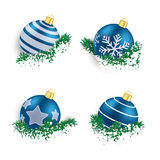 Blue Christmas Baubles in Twigs Snow. Christmas blue baubles with twigs on the white background Stock Photo