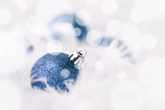 Blue Christmas Baubles. In white feather Stock Image