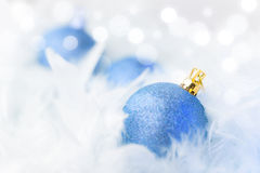 Blue Christmas Baubles. In white feather Stock Photo