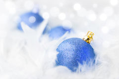 Blue Christmas Baubles. In white feather Royalty Free Stock Photo