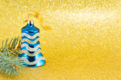 Blue Christmas bell on yellow Royalty Free Stock Photography