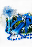 Blue Christmas bells on light background Royalty Free Stock Photos