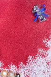 Blue Christmas Bells and Snowflake on red background Royalty Free Stock Images