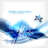 Blue Christmas blurred waves and snowflakes Stock Photo