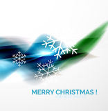 Blue Christmas blurred waves and snowflakes Stock Images