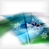 Blue Christmas blurred waves and snowflakes Stock Photos