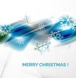 Blue Christmas blurred waves and snowflakes Stock Photography