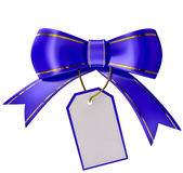 Blue Christmas bow with label Stock Image