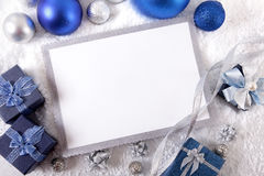 Blue Christmas card background with decorations and copy space Stock Image
