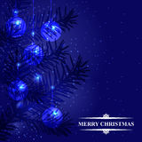 Blue Christmas card with firs branches and baubles Stock Images