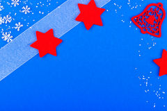 Blue christmas card with red bell and stars Stock Image