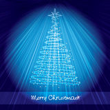 Blue christmas card with shining christmas tree. Christmas card with shining christmas tree on luminous blue background with rays of light Royalty Free Stock Image