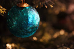 Christmas bauble. A close-up of a  glass bauble on a fir branch Stock Image