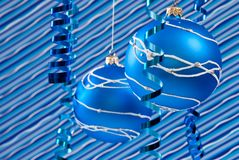 Blue christmas decoration. Christmas decoration from two blue balls on blue background Royalty Free Stock Image