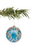 Blue Christmas decoration ball. Closeup of blue Christmas bauble on branch Royalty Free Stock Photos