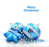 Blue christmas decoration baubles on white Royalty Free Stock Photography