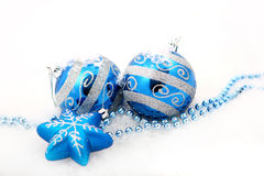 Blue christmas decoration baubles on white Stock Photography