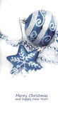 Blue christmas decoration baubles on white. Colorful blue christmas decoration baubles on white with space for text. (shallow DoF Stock Image